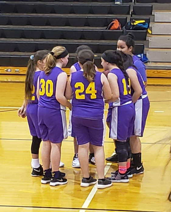 5th and 6th grade praying before the game.