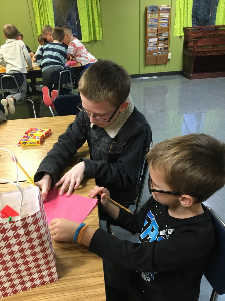Verona Wild Clovers 4-H Club decorating boxes and making Christmas Cards for the Shoe Boxes for Soldiers campaign!