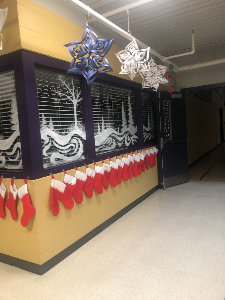 Windows painted by graphic design students. Snowflakes created by grades 4-12