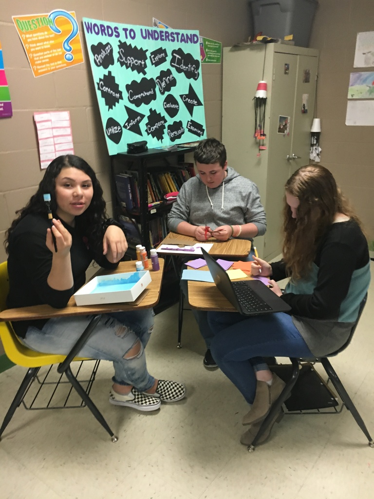 Jennifer, Sebastian, and Kiara using team work to teach poetry